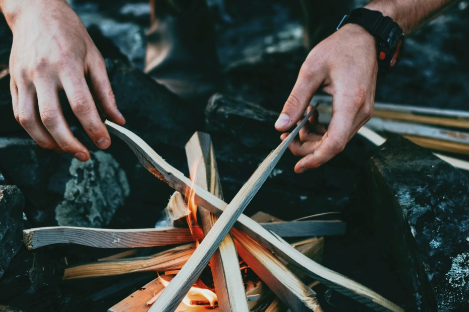 Man building a campfire